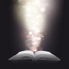 打开的书与闪亮的光效背景