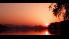 美轮美奂的日出角楼夜景水上道路延时视频素材