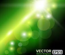 绿色渐变放射光效光斑背景
