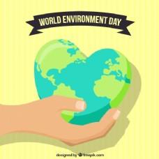 世界环境日背景与手持地球仪与心形