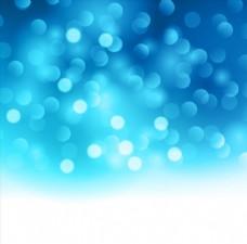 蓝色渐变背景上的圆形光斑